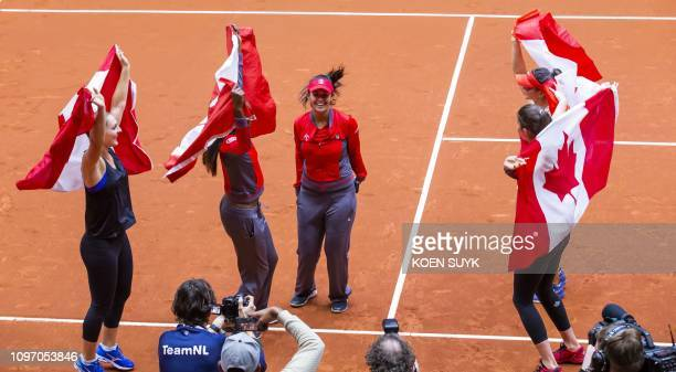 Canada's players Gabriela Dabrowski Francoise Abanda Heidi El Tabakh Bianca Andreescu and Rebecca Marino celebrate after winning against the...