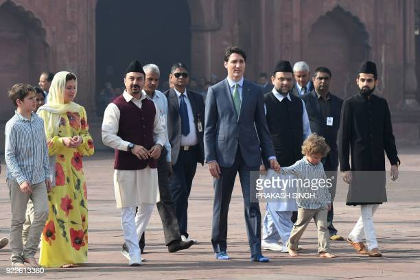 Canada's Prime Minister Justin Trudeau and his wife Sophie Gregoire Trudeau walk around the Jama Masjid one of India's largest mosques with their...