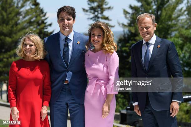 Canada's Prime Minister Justin Trudeau and President of the European Council Donald Tusk stand with their wives Malgorzata Tusk and Sophie Gregoire...