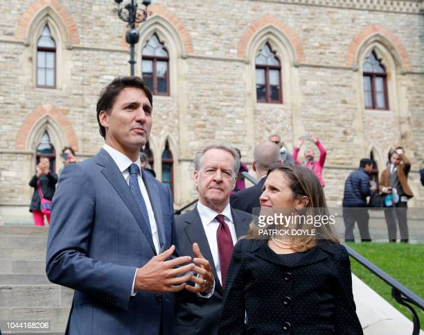 Canada's Prime Minister Justin Trudeau Canada's chief trade negotiator Steve Verheul and Minister of Foreign Affairs Chrystia Freeland walk to a...