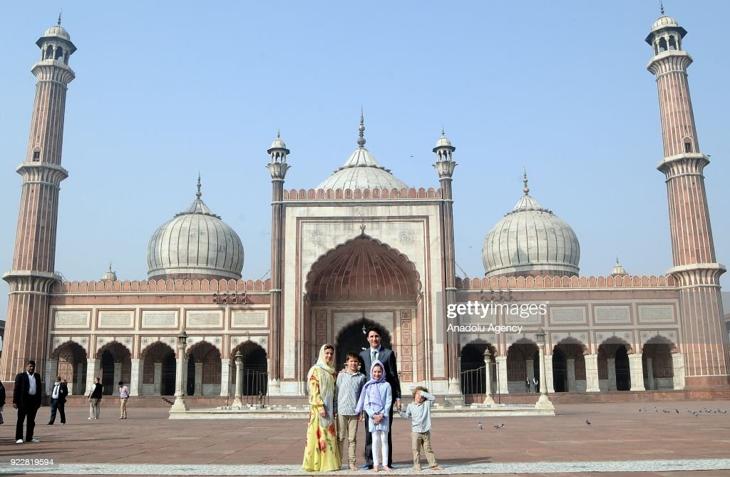 Canada's Prime Minister Justin Trudeau (rear), his wife Sophie Gregoire Trudeau (L), their daughter Ella-Grace (2 R), Xavier (2 L) and Hadrien (R) pose for a photo in front of the Jama Masjid, one of the largest mosques in New Delhi during an official visit on February 22, 2018 in New Delhi, India.