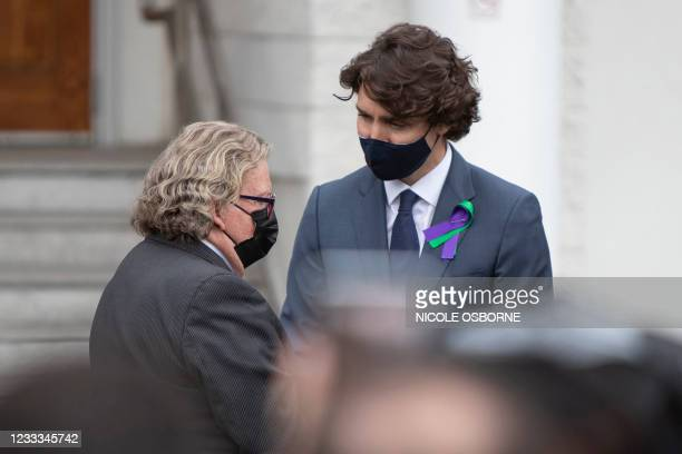 Canada's Prime Minister Justin Trudeau is greeted by London's Mayor Ed Holder during a vigil for the victims of the deadly vehicle attack on five...
