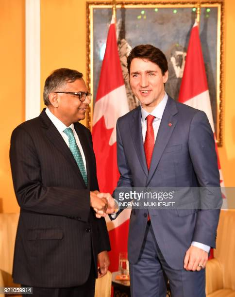Canada's Prime Minister Justin Trudeau is greeted by the chairman of Tata Sons Natarajan Chandrasekaran during a meeting in Mumbai on February 20...