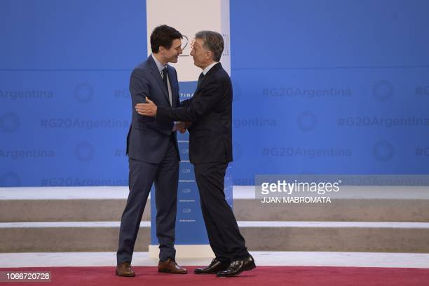 Canada's Prime Minister Justin Trudeau is welcomed by Argentina's President Mauricio Macri at Costa Salguero in Buenos Aires during the G20 Leaders'...
