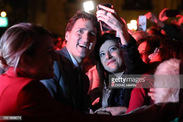 Canada's Prime Minister Justin Trudeau poses for a selfie picture with a woman during a concert in memory of the late French-Armenian...