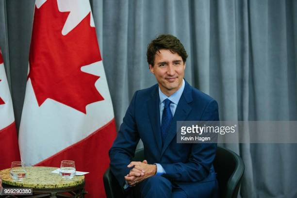 Canada's Prime Minister Justin Trudeau smiles for photos during his meeting with AppNexus President Michael Rubenstein on May 16 2018 in New York City