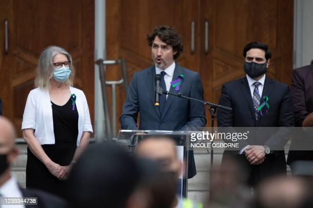 Canada's Prime Minister Justin Trudeau speaks from the podium at a vigil for the victims of the deadly vehicle attack on five members of the Canadian...