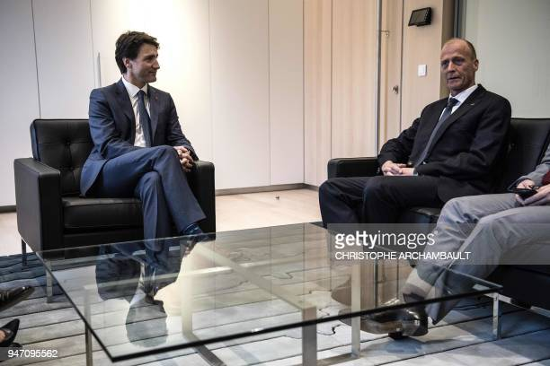 Canada's Prime Minister Justin Trudeau speaks with Airbus CEO Tom Enders during a meeting at the newlyopened Canadian Embassy as part of his official...