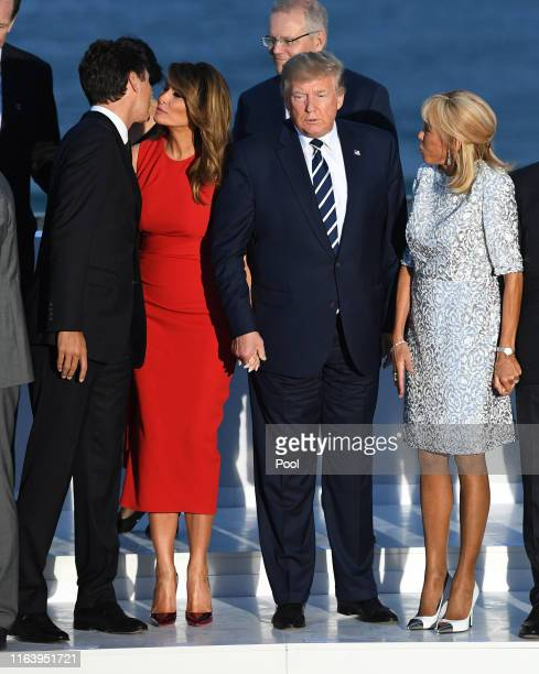 Canada's Prime Minister Justin Trudeau US First Lady Melania Trump US President Donald Trump French President's wife Brigitte Macron join G7 leaders...