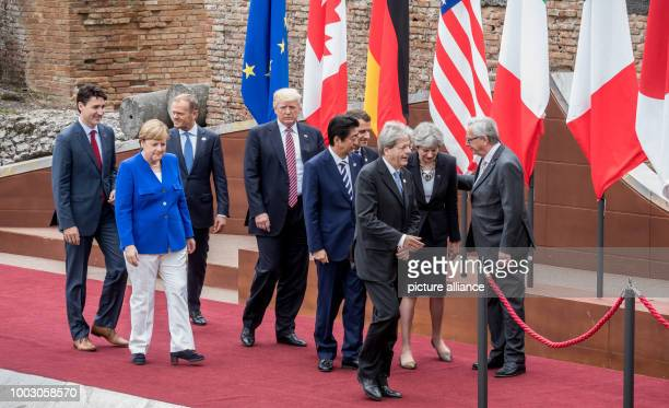 Canada's Prime Minister Justin Trudeau walks behind Germany's Chancellor Angela Merken President of the European Council Donald Tusk US President...