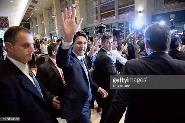 Canada's Prime Minister Justin Trudeau waves to members of the media and summit volunteers as he leaves after a press conference at the AsiaPacific...