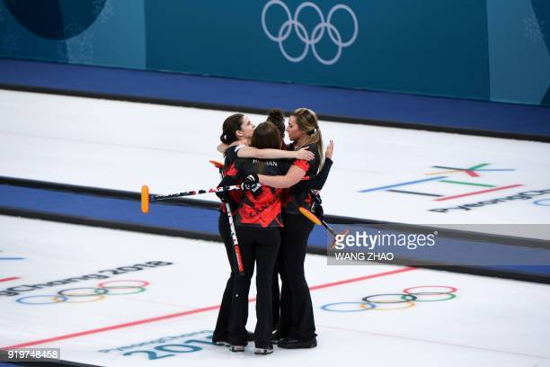 TOPSHOT Canada's Rachel Homan celebrates with her teammates after winning the curling women's round robin session between Canada and Switzerland...