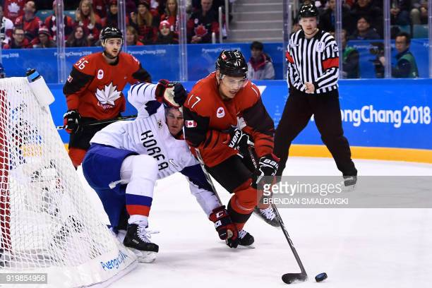 Canada's Rene Bourque controls the puck in the men's preliminary round ice hockey match between Canada and South Korea during the Pyeongchang 2018...
