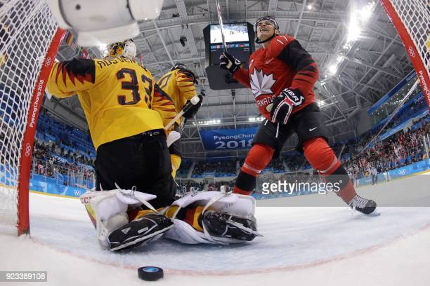 Canada's Rene Bourque reacts after teammate Canada's Derek Roy scored against Germany's Danny aus den Birken in the men's semifinal ice hockey match...