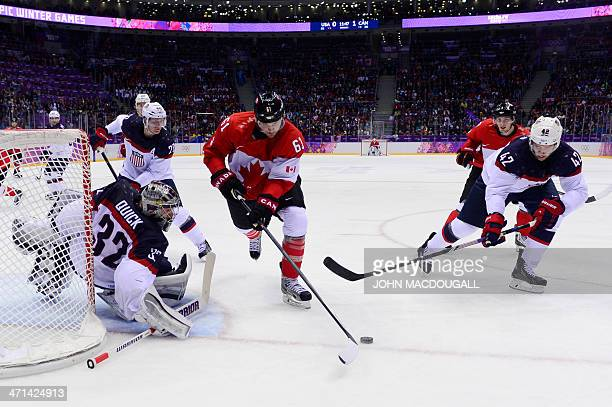 Canada's Rick Nash tries to score against US goalkeeper Jonathan Quick and US David Backes during the Men's Ice Hockey Semifinals USA vs Canada at...