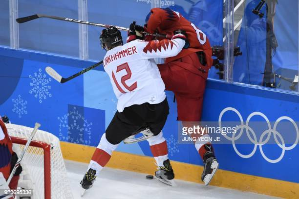Canada's Rob Klinkhammer collides with a Czech Republic player in the men's bronze medal ice hockey match between the Czech Republic and Canada...