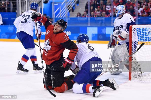 Canada's Rob Klinkhammer reacts after clashing with South Korea's Bryan William Young in the men's preliminary round ice hockey match between Canada...