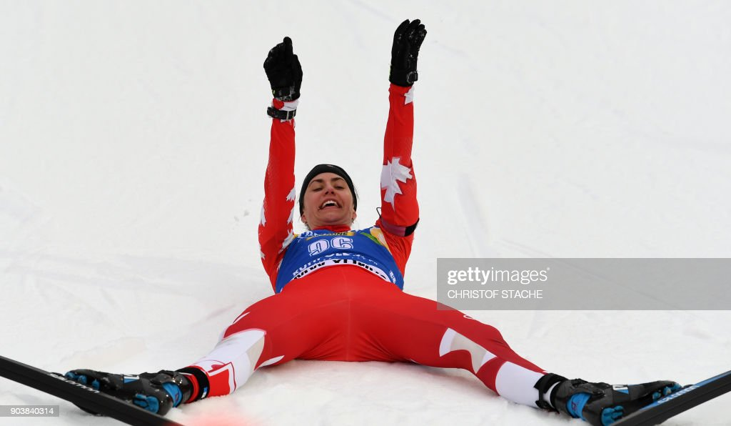Canada's Rosanna Crawford celebrates her third place in the women's 15 km individual event at the Biathlon World Cup on January 11, 2018 in Ruhpolding, southern Germany. /