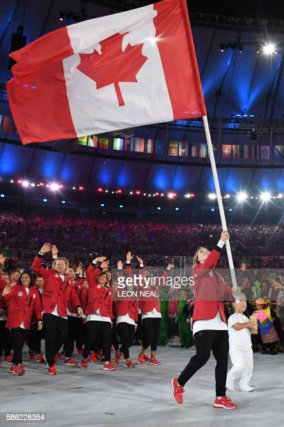 Canada's Rosannagh Maclennan carries the flag during the opening ceremony of the Rio 2016 Olympic Games at the Maracana stadium in Rio de Janeiro on...