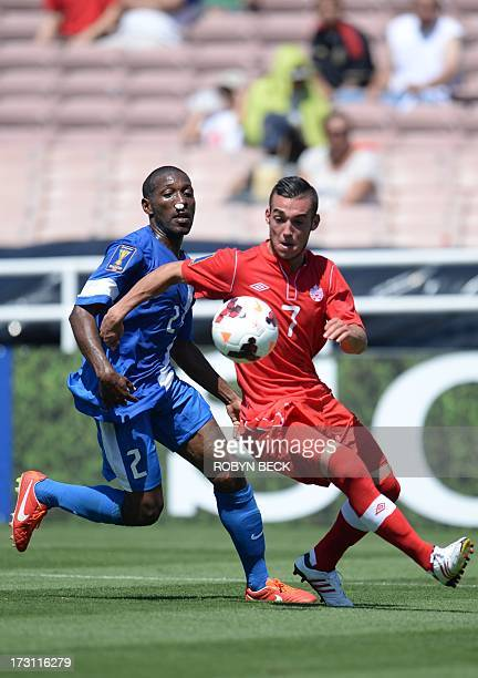 Canada's Russell Teibert vies for the ball with Martinique's Nicolas Zaire during the 2013 CONCACAF Gold Cup opener on July 7 2013 at the Rose Bowl...