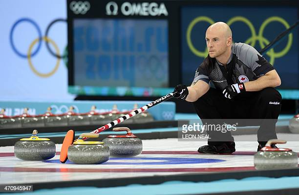 Canada's Ryan Fry moves a stone during the Men's Curling Gold Medal Game between Canada and Great Britain at the Ice Cube Curling Center in Sochi...