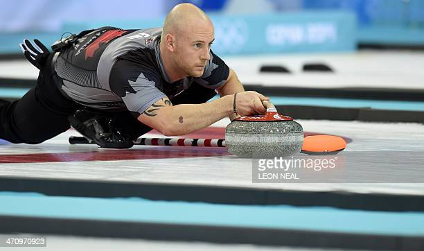 Canada's Ryan Fry throws the stone during the Men's Curling Gold Medal Game between Canada and Great Britain at the Ice Cube Curling Center in Sochi...