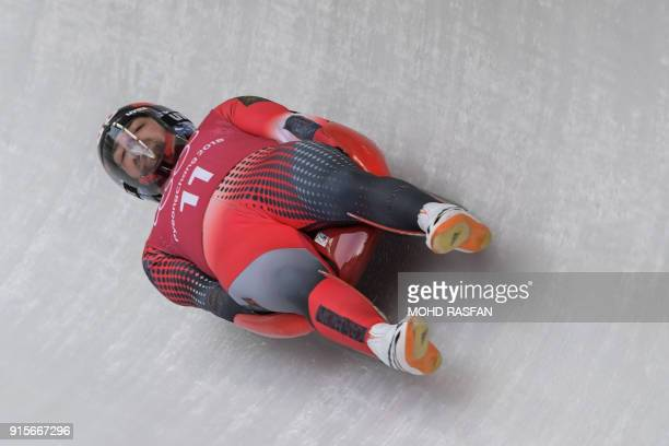 Canada's Sam Edney takes a corner during a training session for the men's luge singles during the Pyeongchang 2018 Winter Olympic Games at the...