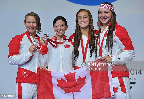 Canada's Samantha Cheverton Brittany Maclean Alyson Ackman and Emily Overholt pose on the podium during the Women's 4 x 200m Freestyle medal ceremony...