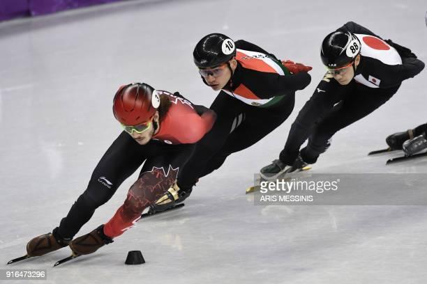 Canada's Samuel Girard , Hungary's Sandor Liu Shaolin and Japan's Hiroki Yokoyama take part in the men's 1,500m short track speed skating heat event...