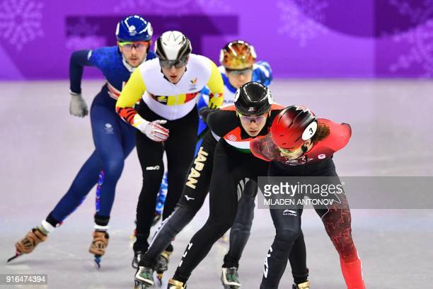 Canada's Samuel Girard leads the men's 1,500m short track speed skating heat event during the Pyeongchang 2018 Winter Olympic Games, at the Gangneung...