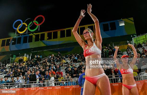 Canada's Sarah Pavan and Heather Bansley enter the pitch before their the women's beach volleyball qualifying match against Germany at the Beach...