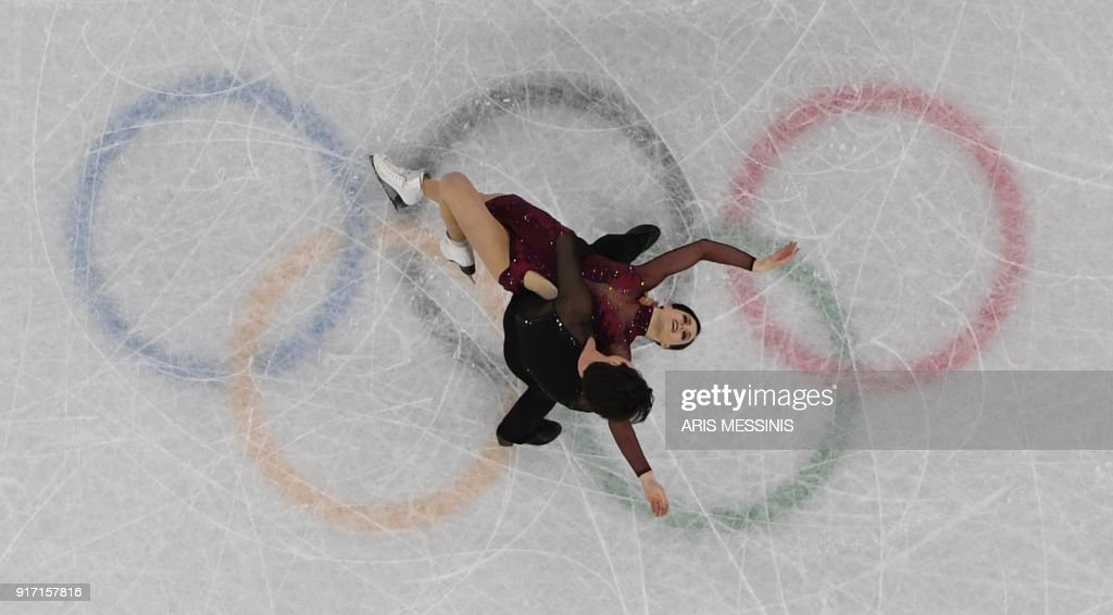 Canada's Scott Moir and Canada's Tessa Virtue compete in the figure skating team event ice dance free dance during the Pyeongchang 2018 Winter Olympic Games at the Gangneung Ice Arena in Gangneung on February 12, 2018. / AFP PHOTO / Aris MESSINIS