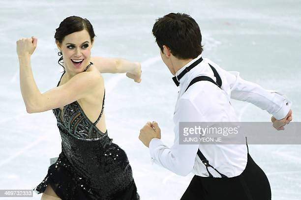 Canada's Scott Moir and Canada's Tessa Virtue perform in the Figure Skating Ice Dance Short Dance at the Iceberg Skating Palace during the Sochi...