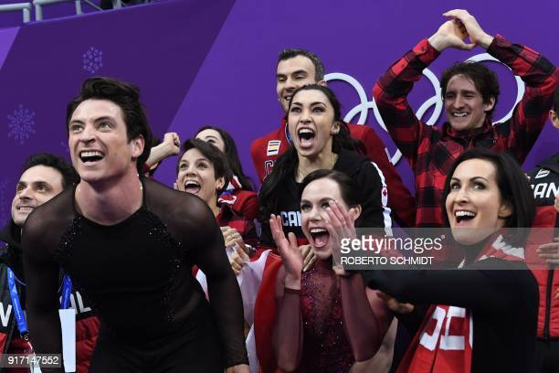 Canada's Scott Moir and Canada's Tessa Virtue react after competing in the figure skating team event ice dance free dance during the Pyeongchang 2018...