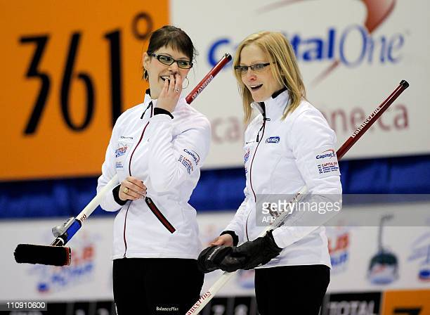 Canadas second Tammy Schneider and third Kim Schneider celebrate after winning the semi-final match of the World Women's Curling Championships...