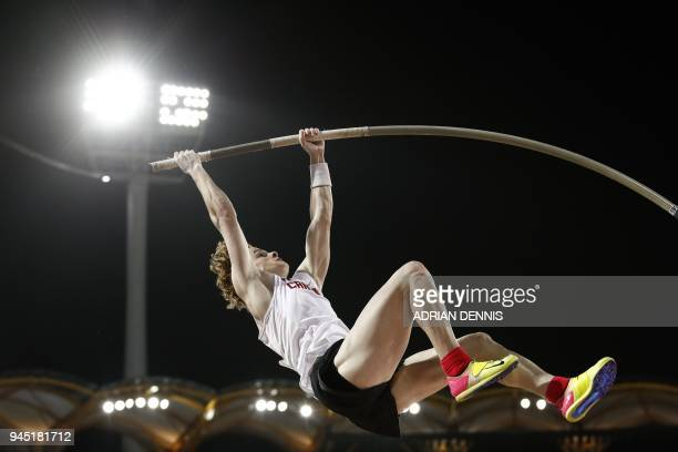 Canadas Shawnacy Barber competes in the athletics men's pole vault final during the 2018 Gold Coast Commonwealth Games at the Carrara Stadium on the...