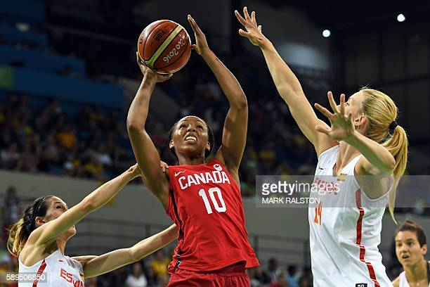 Canada's shooting guard Nirra Fields goes to the basket between Spain's guard Anna Cruz and Spain's power forward Laura Gil during a Women's round...
