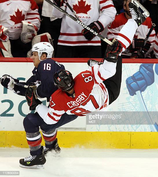 Canada's Sidney Crosby is flipped by Joe Pavelski of the United States on a check in the first period of the men's hockey gold medal game on Sunday...