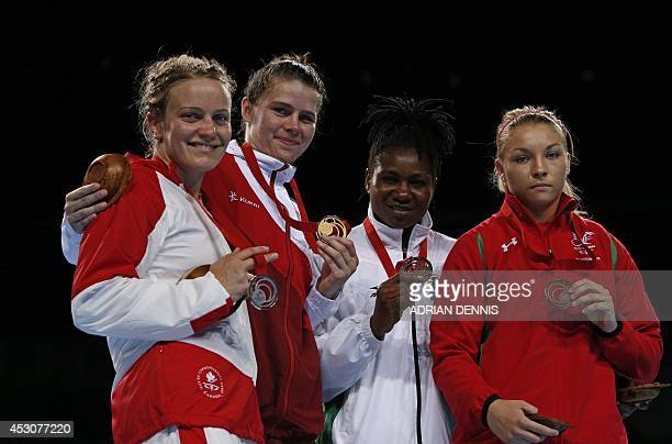 Canada's silver medalist Ariane Fortin England's gold medalist Savannah Marshall Nigeria's Bronze medalist Edith Ogoke and Wales's bronze medalist...