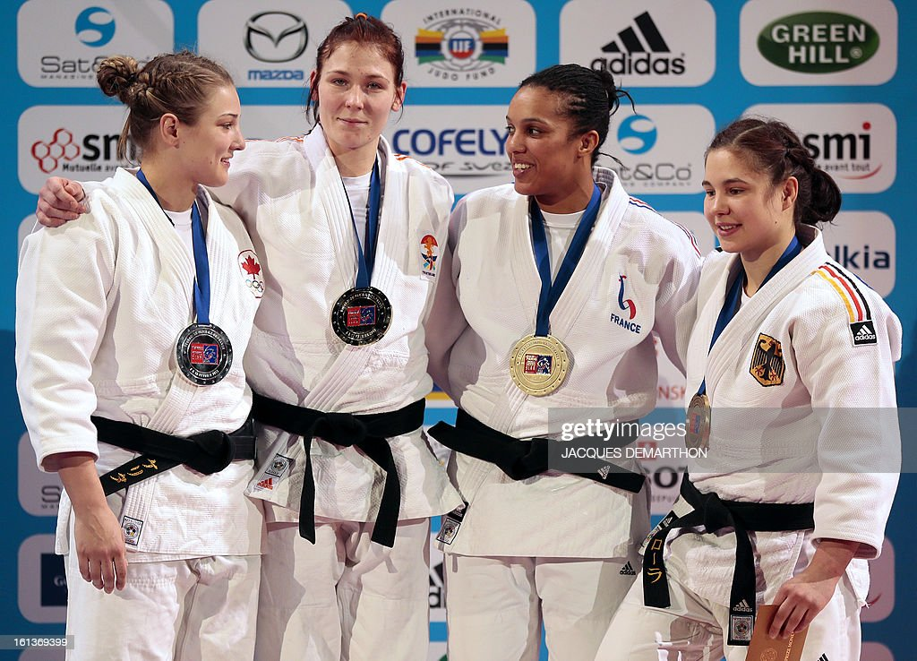 Canada's silver medalist Kelita Zupancic, gold medalist Kim Polling of the Netherlands, France's bronze medalist Lucie Decosse and Germany's bronze medalist Laura Vargas Koch pose on the podium on February 10, 2013 after the Women -70Kg final of the Paris International Judo tournament, part of the Grand Slam, at the Palais Omnisports de Paris-Bercy (POPB) in Paris.