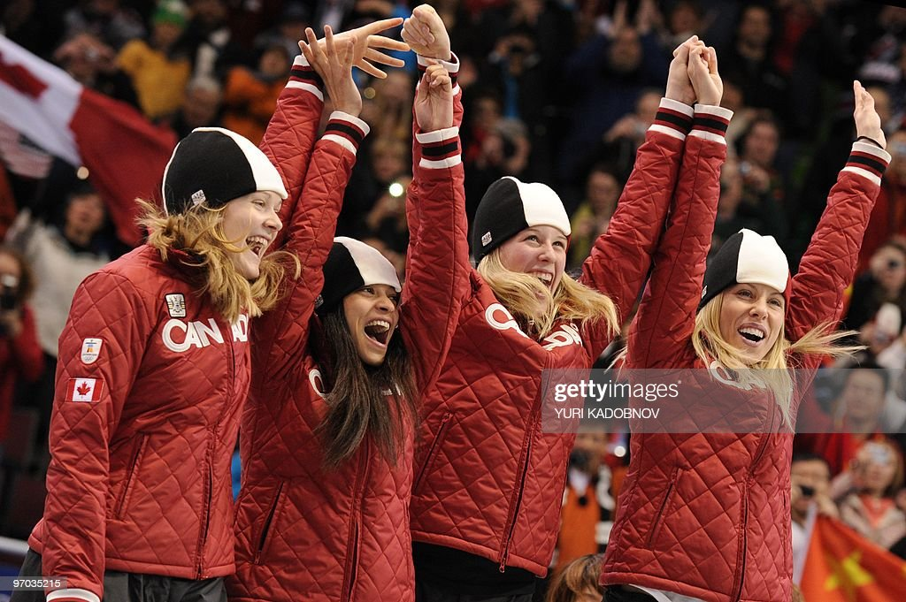 Canada's silver medalists (L to R) Jessica Gregg, Kalyna Roberge, Marianne St. Gelais and Tania Vicent celebrate in the flower ceremony of the Women's Short Track Speedskating 3000m Relay event, at the Pacific Coliseum in Vancouver, during the XXI Winter Olympics on February 24 , 2010. AFP PHOTO / Yuri KADOBNOV