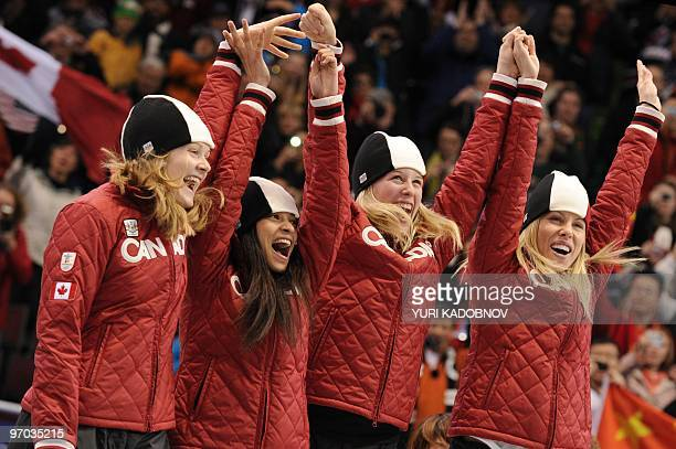 Canada's silver medalists Jessica Gregg Kalyna Roberge Marianne St Gelais and Tania Vicent celebrate in the flower ceremony of the Women's Short...