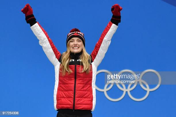 Canada's silver medallist Justine DufourLapointe reacts on the podium during the medal ceremony for the women's freestyle skiing moguls at the...