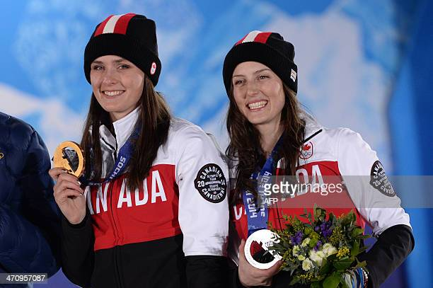Canada's silver medallist Kelsey Serwa and Canada's gold medallist Marielle Thompson pose during the Women's Freestyle Skiing Ski Cross Medal...