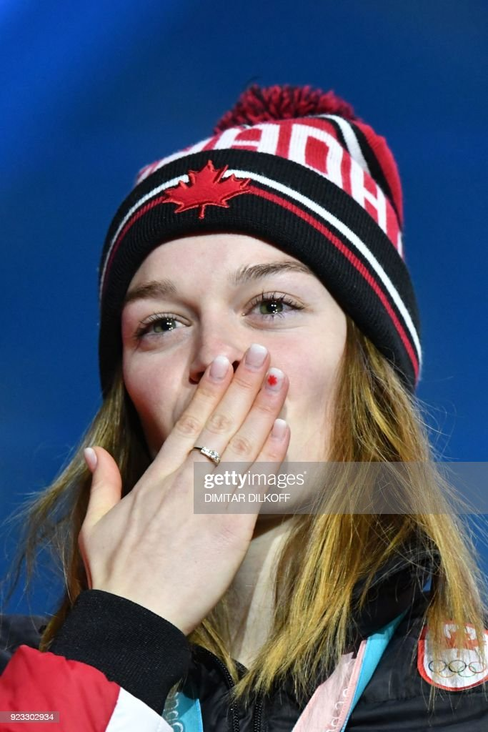 Canada's silver medallist Kim Boutin blows a kiss on the podium during the medal ceremony for the short track Women's 1000m at the Pyeongchang Medals Plaza during the Pyeongchang 2018 Winter Olympic Games in Pyeongchang on February 23, 2018. / AFP PHOTO / Dimitar DILKOFF