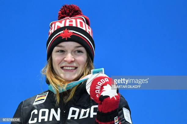 Canada's silver medallist Kim Boutin poses on the podium during the medal ceremony for the short track Women's 1000m at the Pyeongchang Medals Plaza...