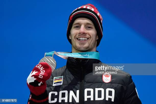 Canada's silver medallist Max Parrot poses on the podium during the medal ceremony for the snowboard Men's Slopestyle at the Pyeongchang Medals Plaza...