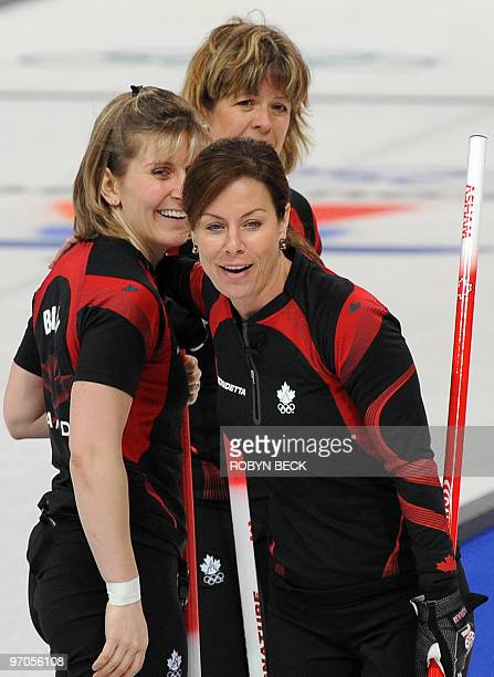 Canada's skip Cheryl Bernard and teammates celebrate after defeating Switzerland 76 women's curling semifinal match against Switzerland at the...