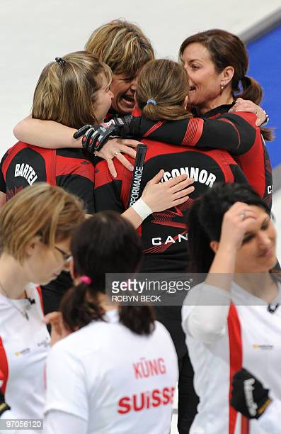 Canada's skip Cheryl Bernard and teammates celebrate after defeating Switzerland in their women's curling semifinal match against Switzerland at the...