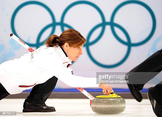Canada's skip Cheryl Bernard throws the stone during their match against Japan in the Vancouver Winter Olympic women's curling games at the Vancouver...
